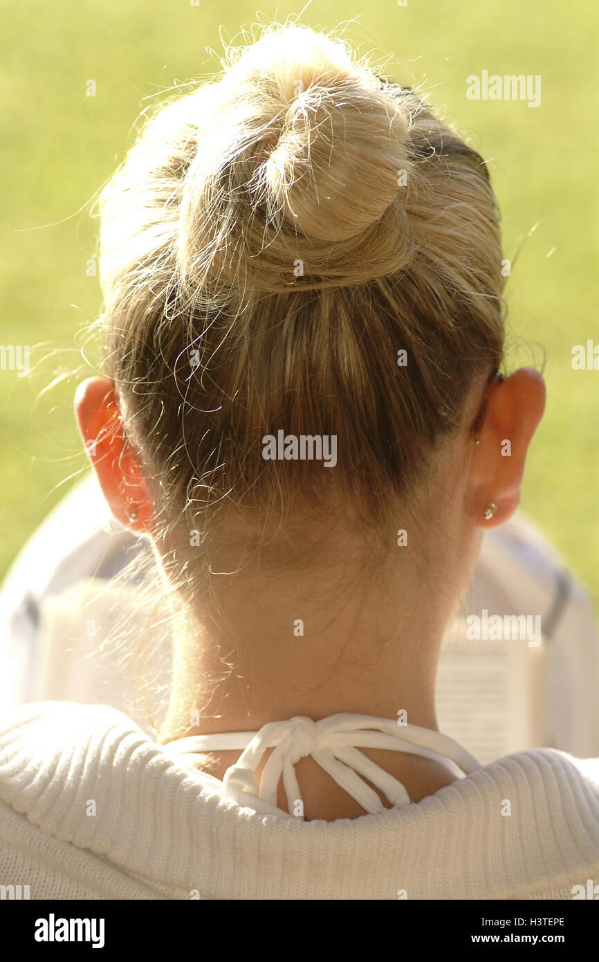 Terrace, woman, young, book, read, hairs, pinned up, back view, garden, summer, outside, leisure time, lifestyle, - Stock Image