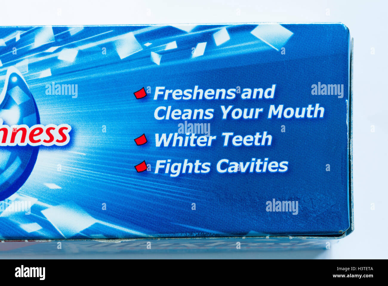 Information on box of Colgate fluoride toothpaste MaxFresh with cooling crystals cool mint - Stock Image