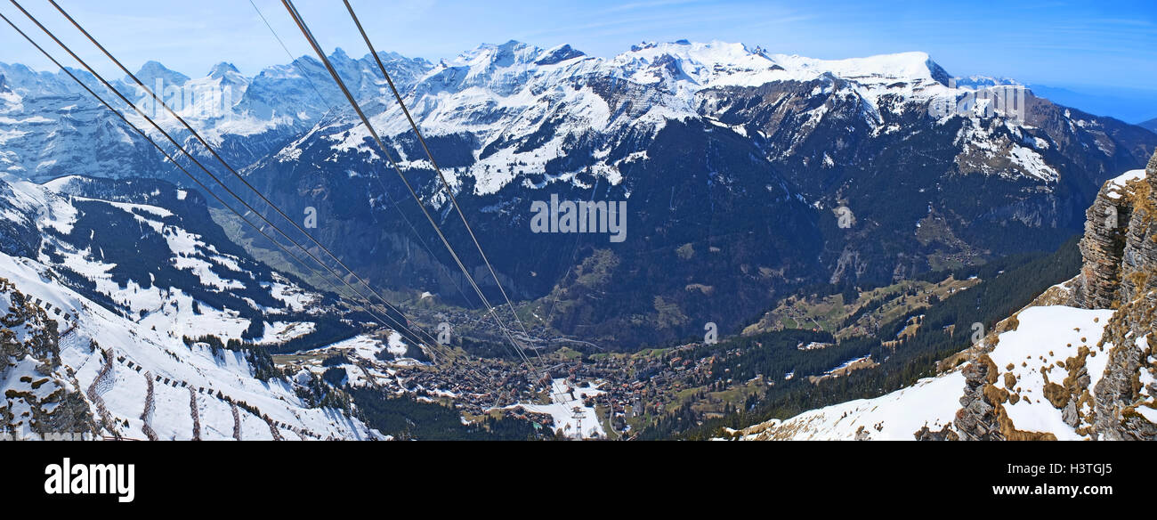 The view on Wengen–Mannlichen aerial cableway and Lauterbrunnen Valley  from the mountain top, Switzerland. Stock Photo