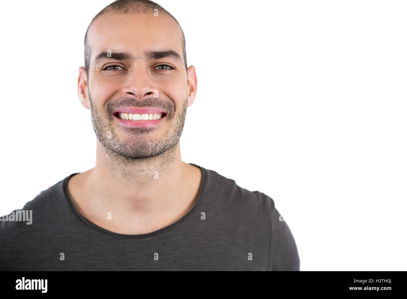 Man smiling against white background - Stock Image