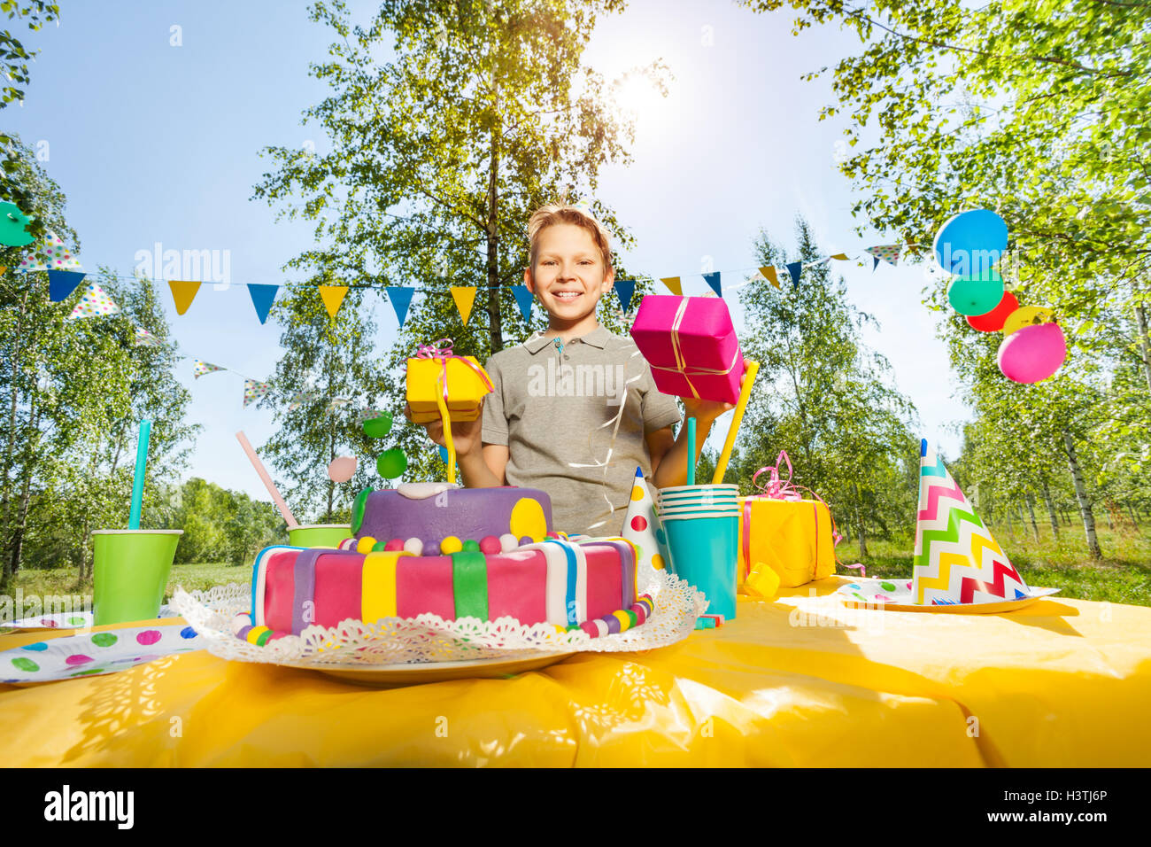 Portrait Of Happy Young Boy Holding Birthday Gifts