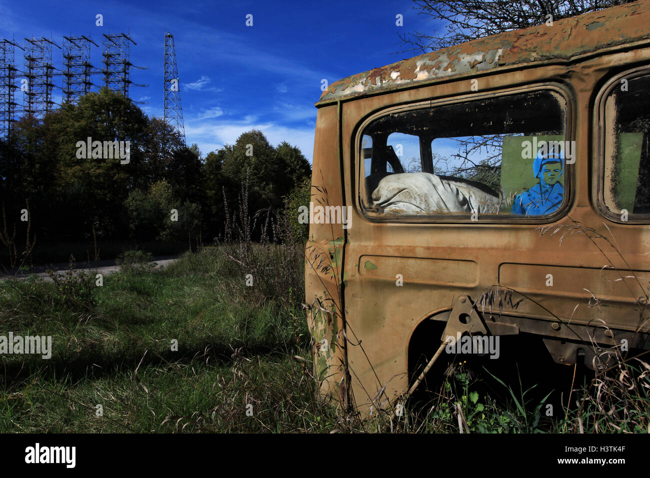 Abandoned car in the former military base Chernobyl-2 around the Soviet radar system Duga-3. Chernobyl Exclusion - Stock Image