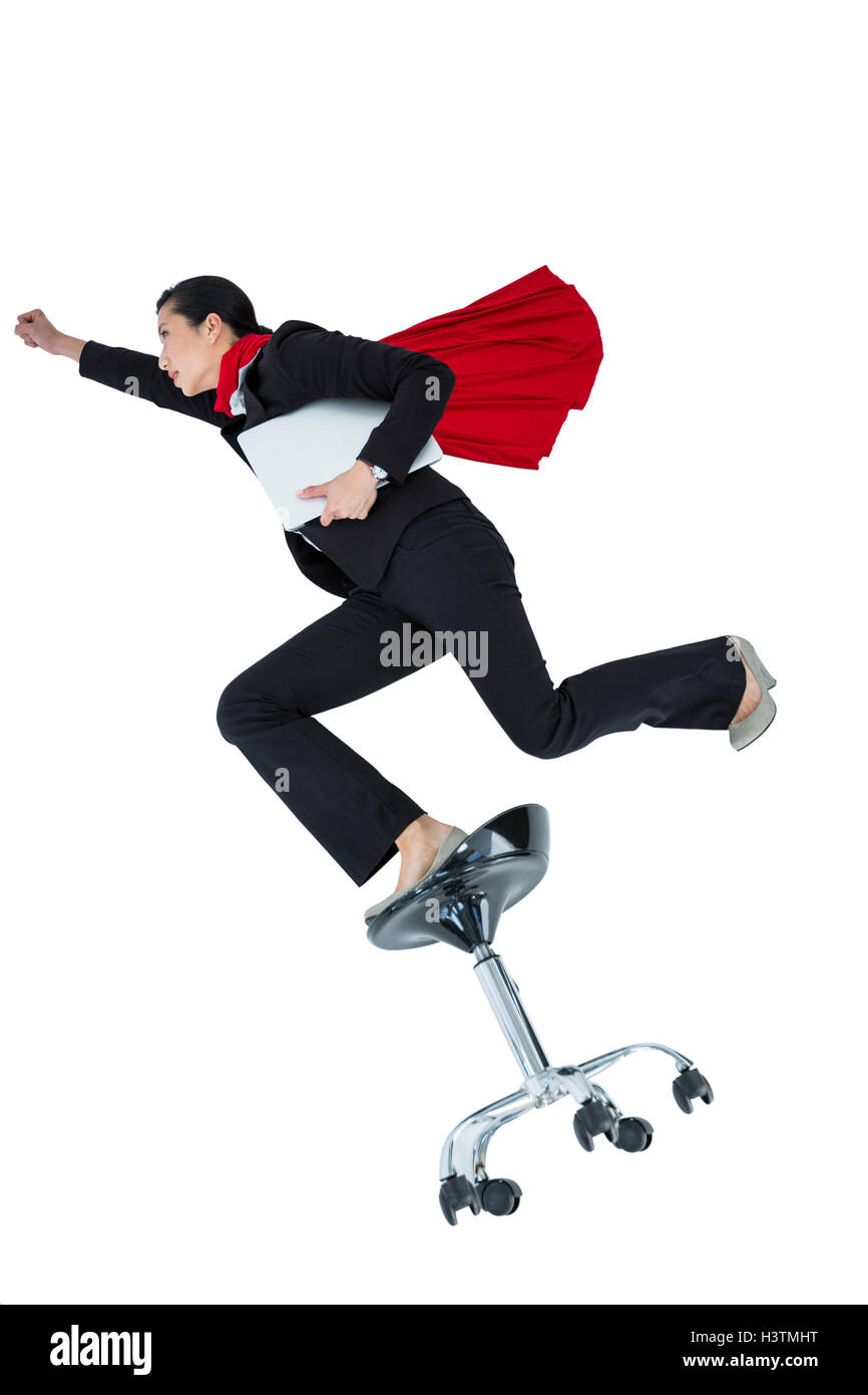 Woman pretending to be a super hero - Stock Image
