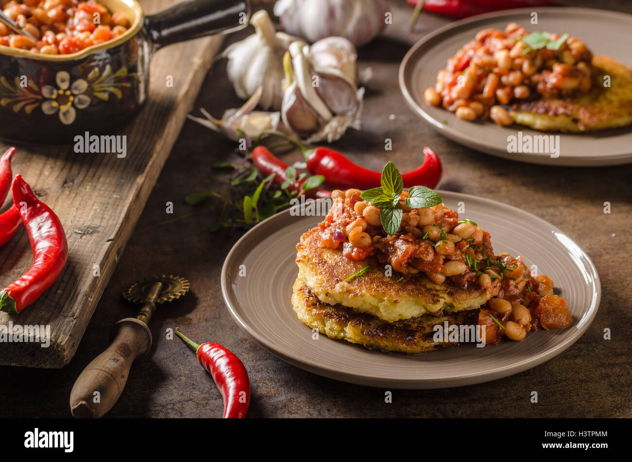 Bake beans with fluffy potato cakes, spicy and delicious breakfast - Stock Image