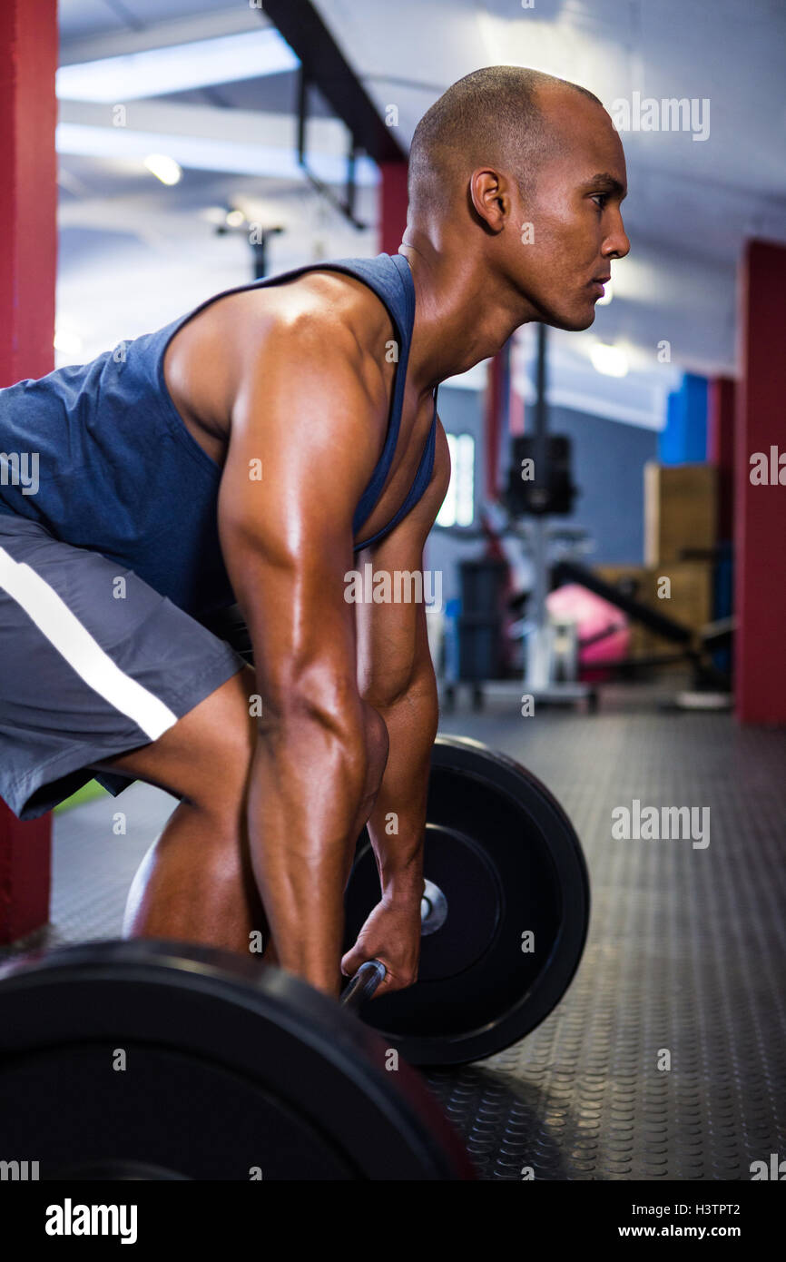 Male athlete lifting barbell - Stock Image