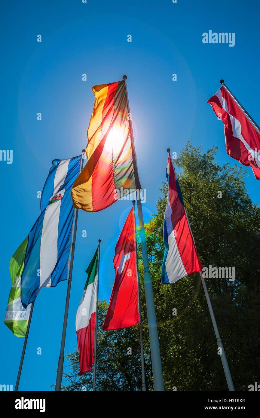 National flags on flagpole in Oberstaufen, Allgäu, Bavaria, Germany Stock Photo