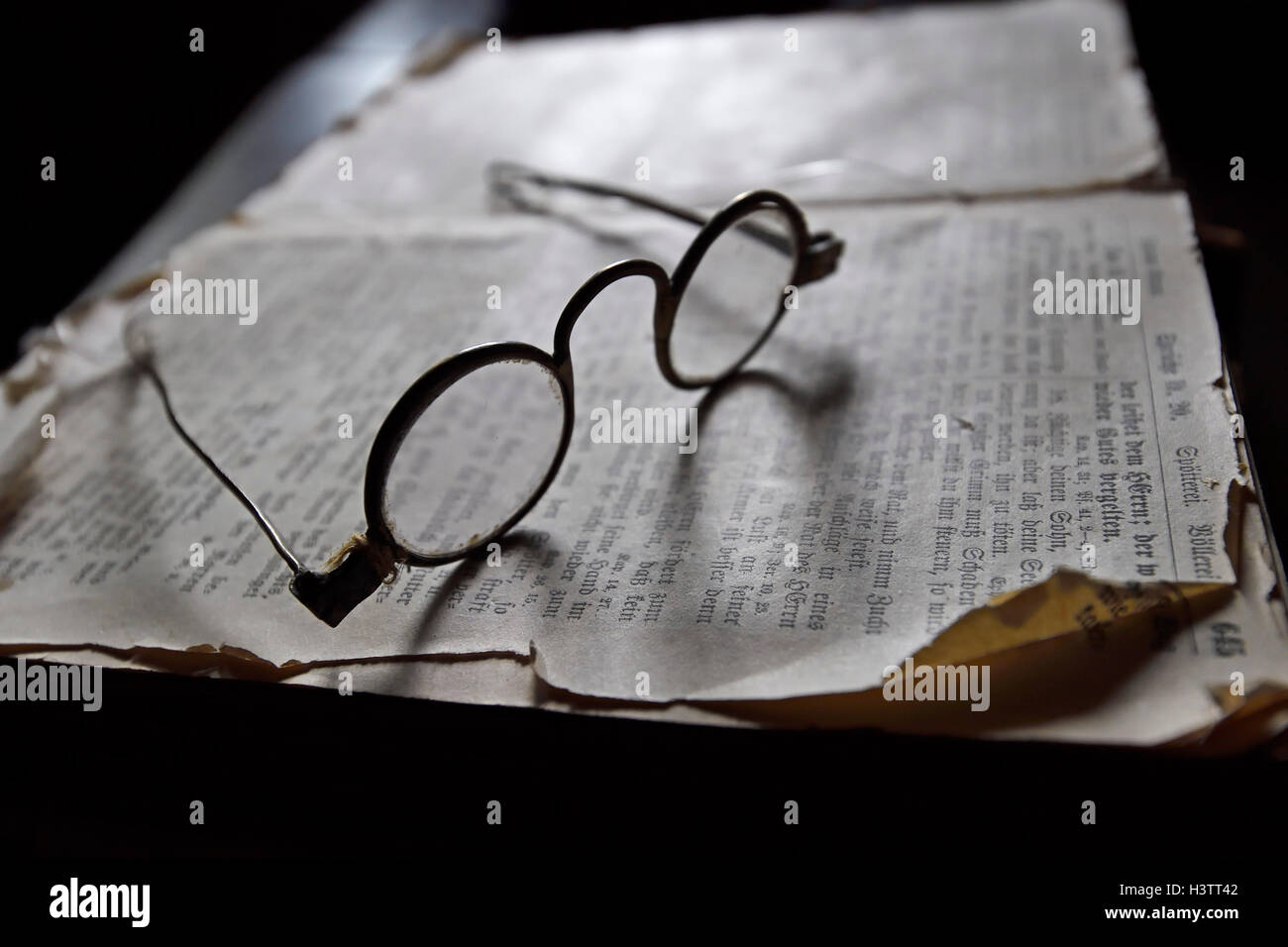 Old spectacles on historic book, Museum old Frisian house, Keitum, Sylt, North Frisian Islands, North Frisia, Schleswig - Stock Image