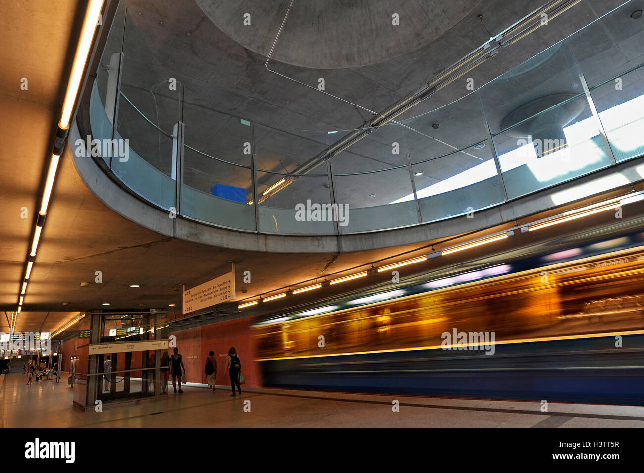 Metro station with arriving metro, Messestadt-West, Munich, Bavaria, Germany - Stock Image