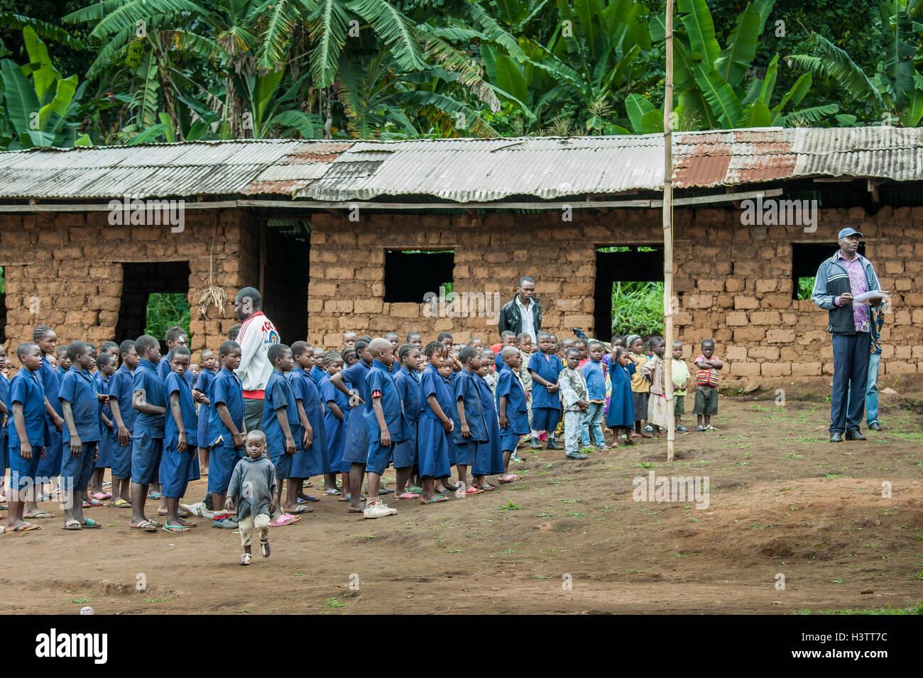 Schoolchildren in uniforms, schoolyard, Foumbam, West Region, Cameroon, Africa - Stock Image