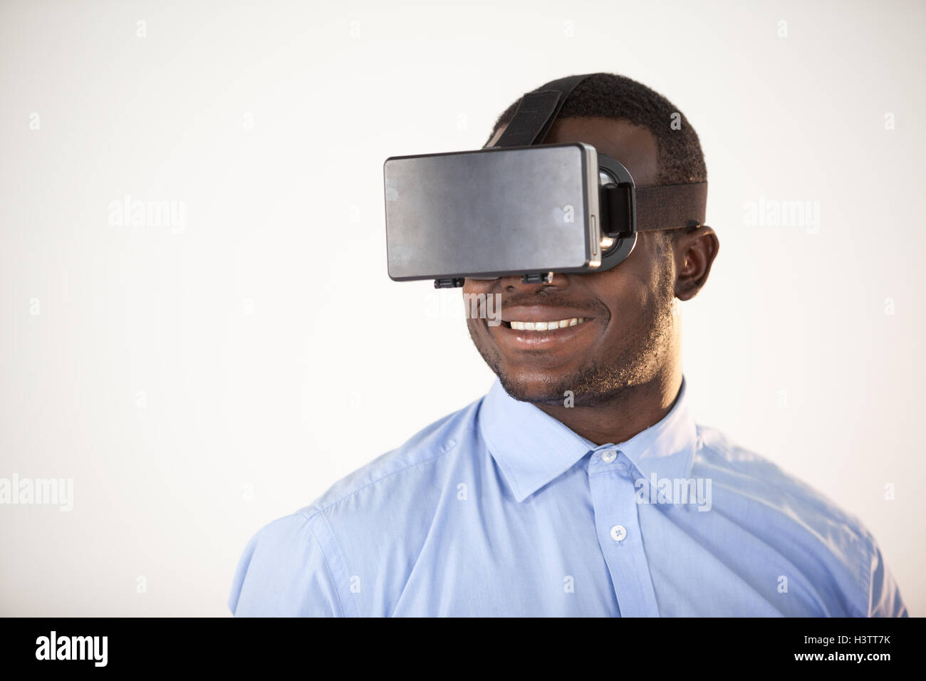 Man using virtual reality headset - Stock Image