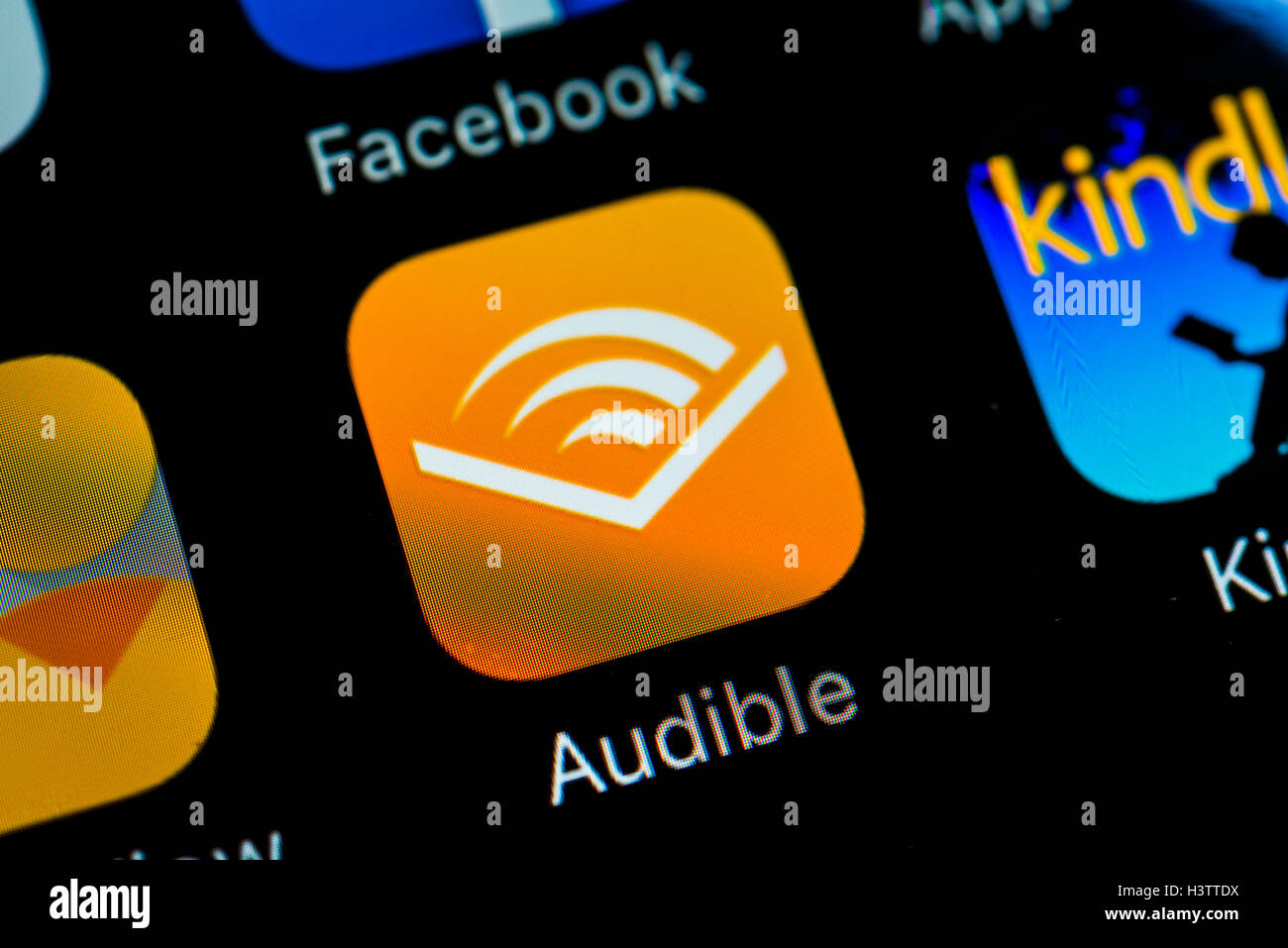 Smartphone screen with Audible app icon in detail - Stock Image