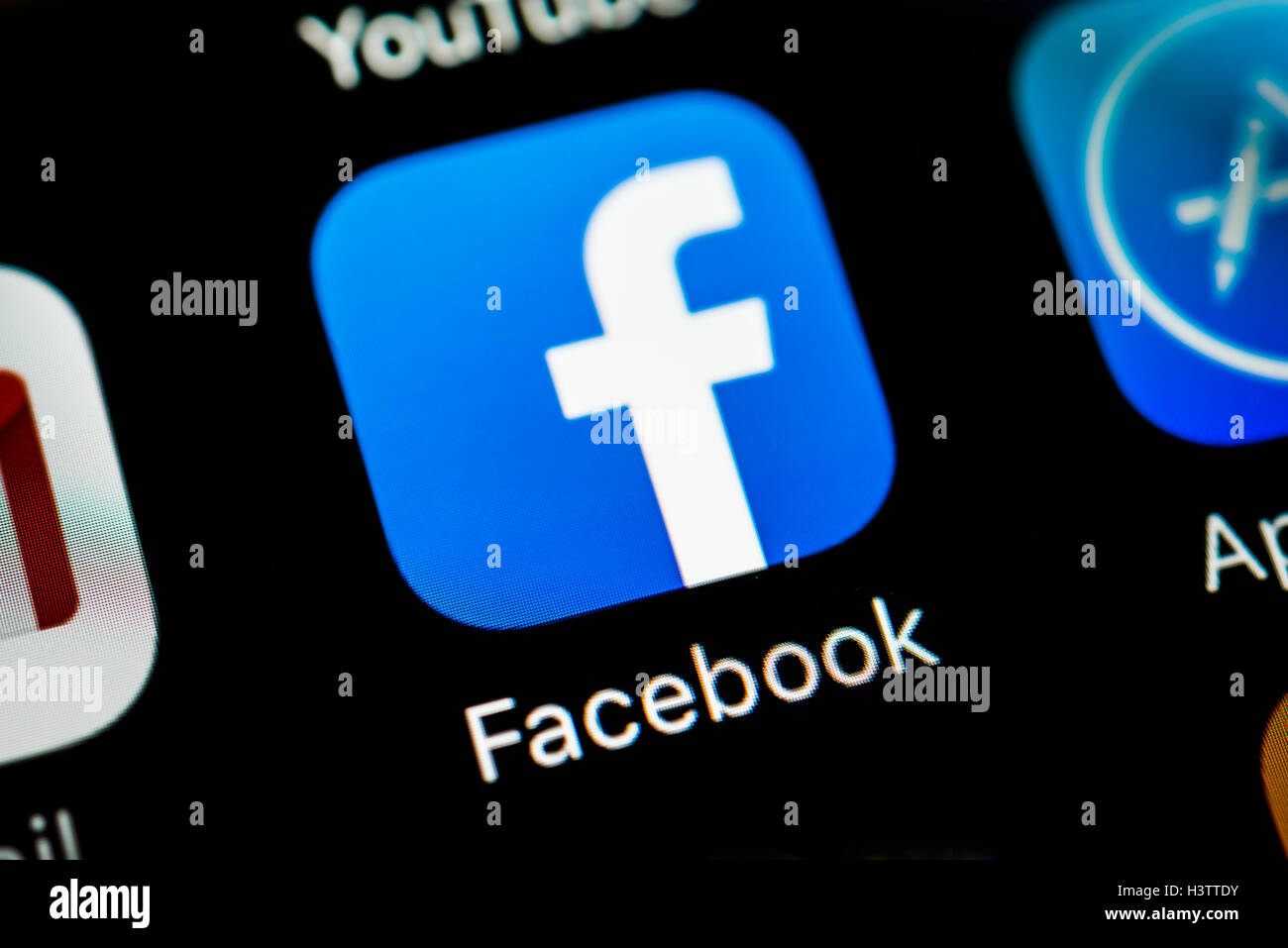 Smartphone screen with Facebook app icon - Stock Image