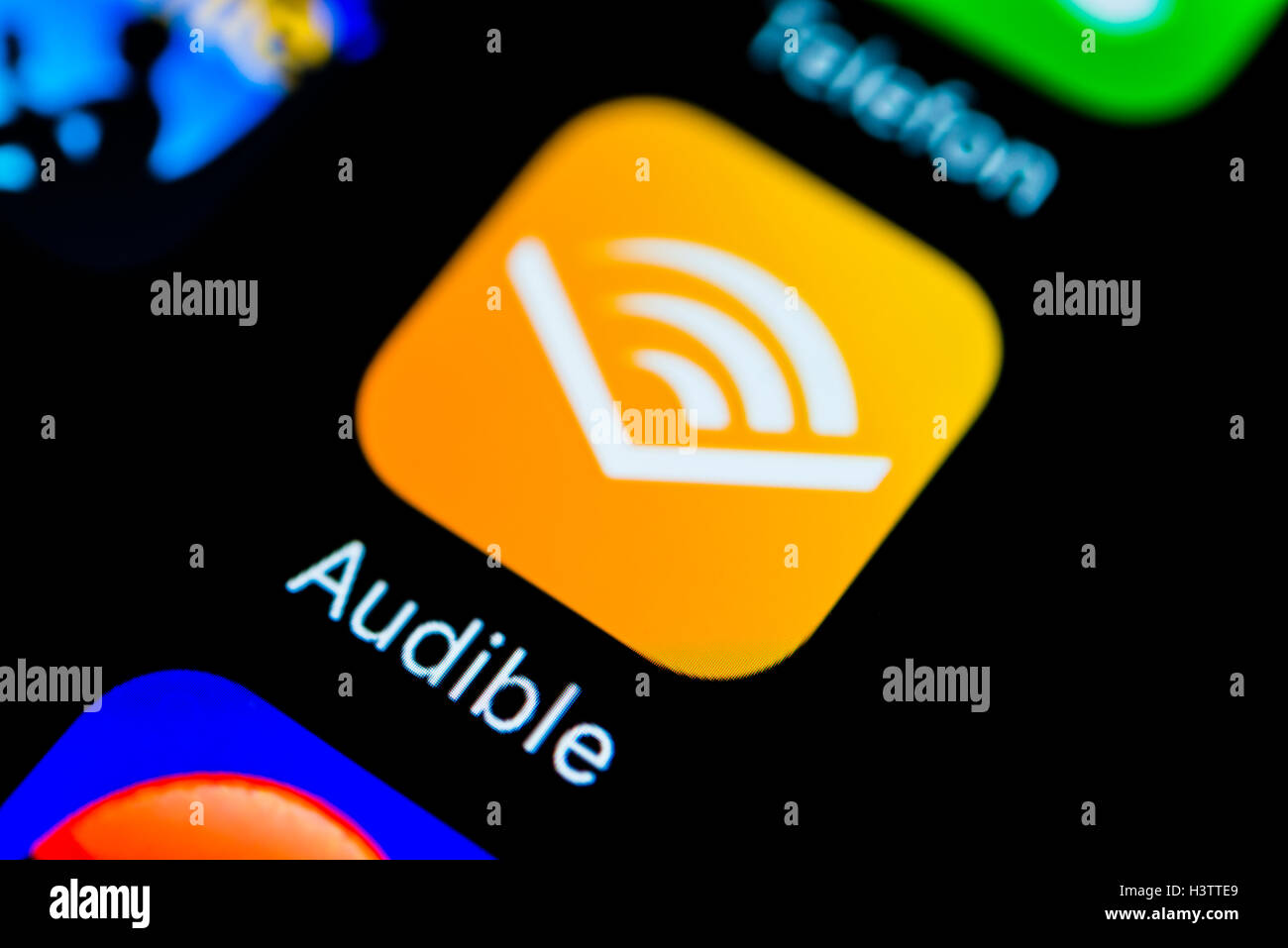Audible app icon, displayed on smartphone screen - Stock Image