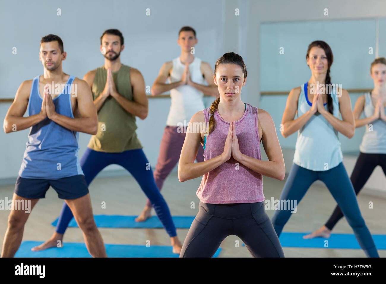 Instructor taking yoga class - Stock Image