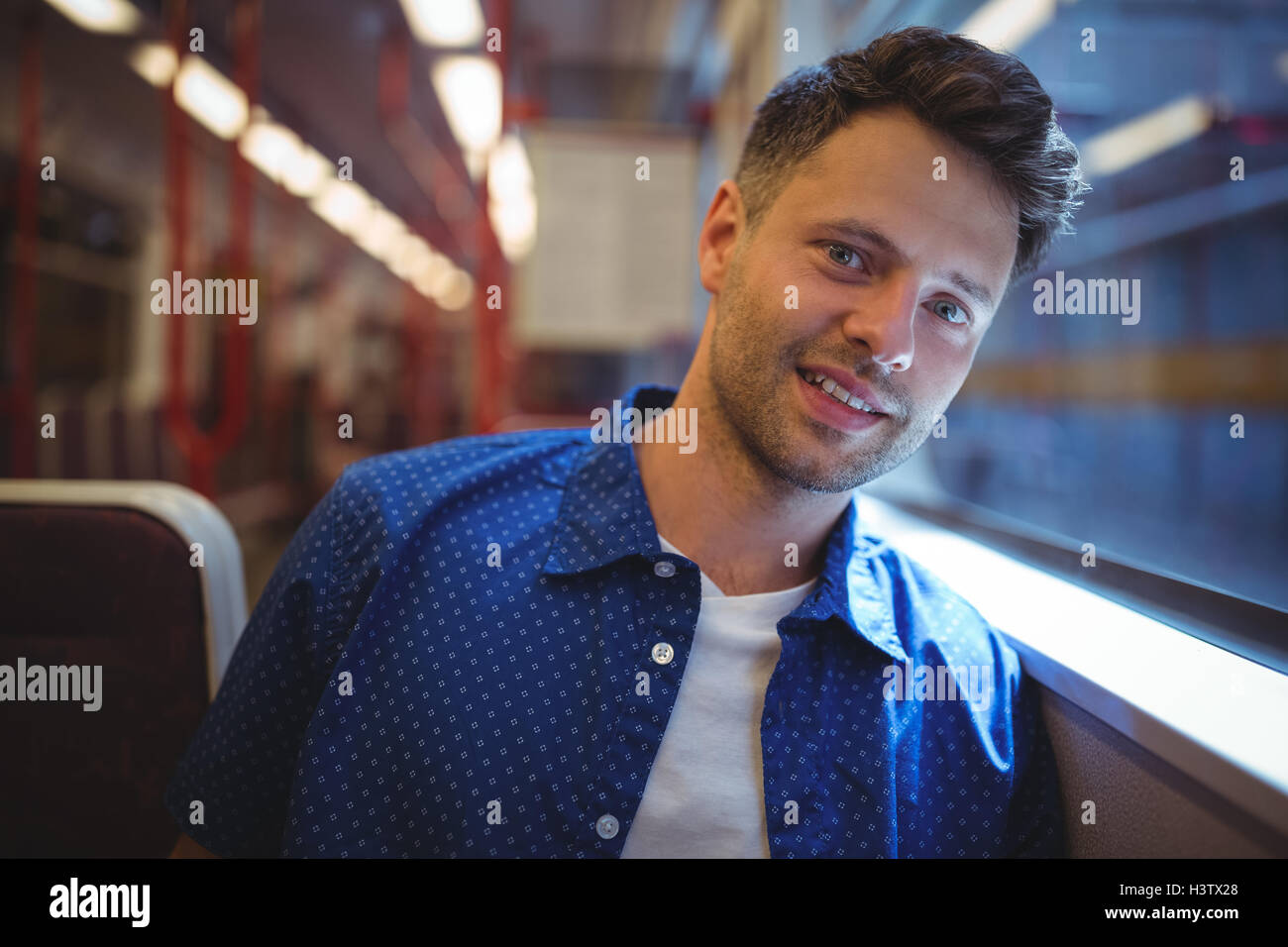 Handsome man looking through window - Stock Image