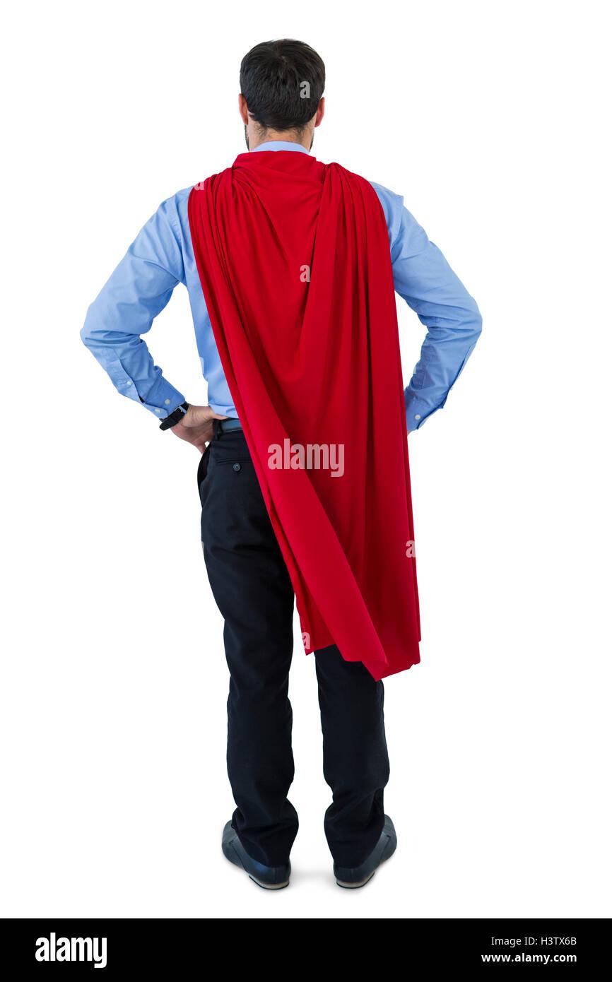 Businessman pretending to be a super hero - Stock Image