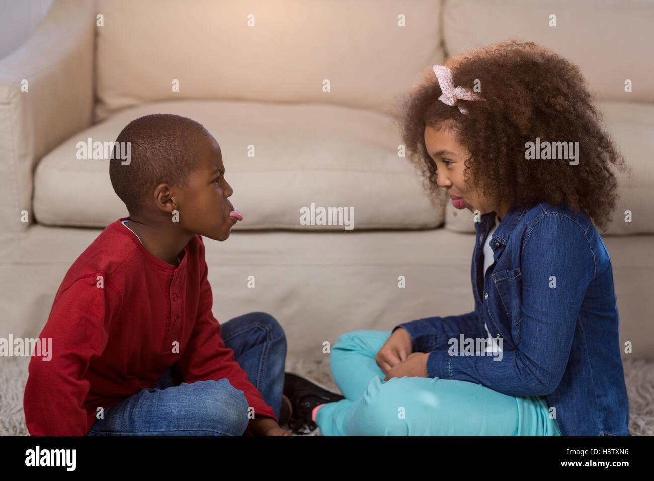 Children teasing each other - Stock Image