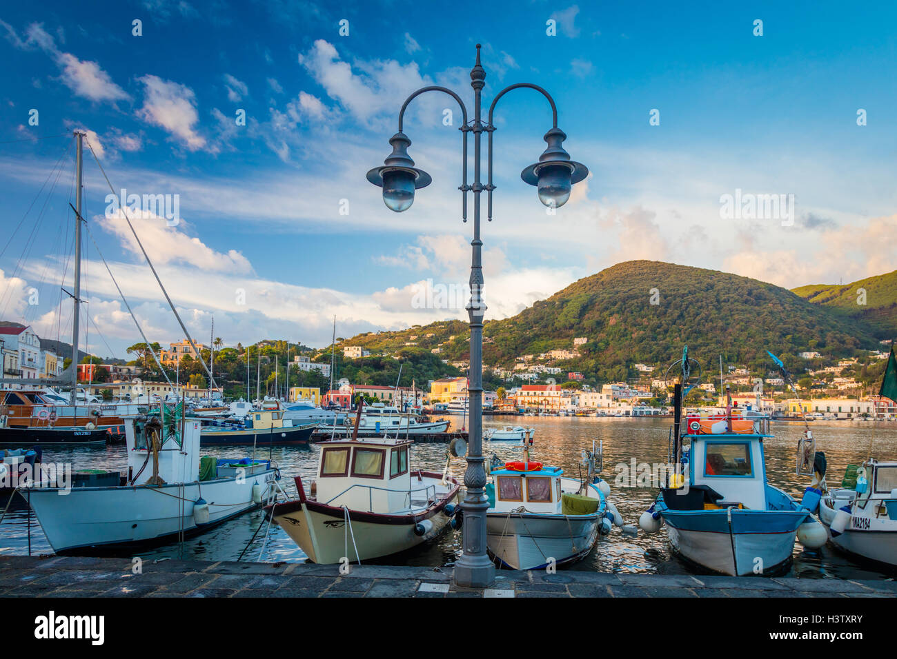 Ischia is a volcanic island in the Tyrrhenian Sea. Seen here is the main commune on the island, Ischia Porto. - Stock Image