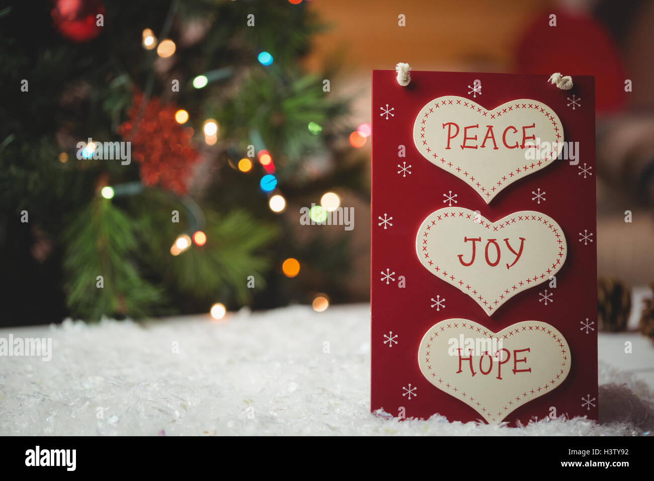 Christmas label with massages of peace, joy and hope - Stock Image