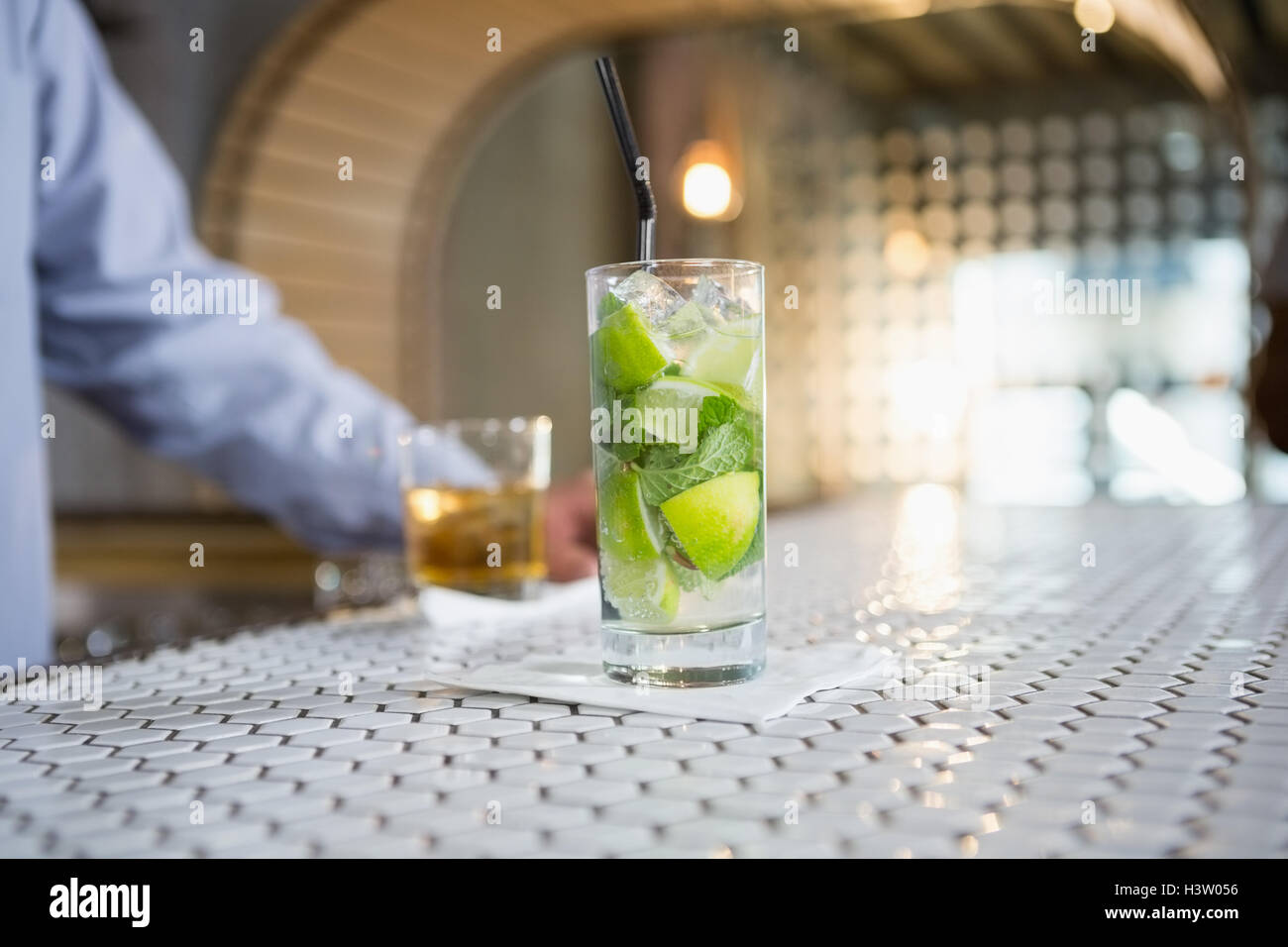 Glass of gin on bar counter - Stock Image