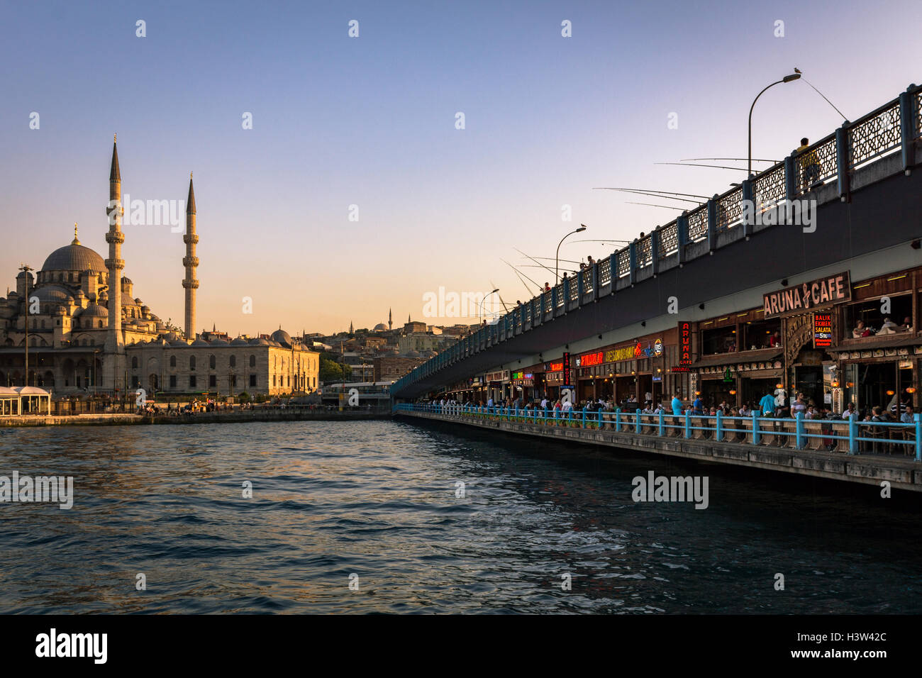 The view afforded from Galata bridge, above and below, with the New Mosque in the background, in Istanbul (Turkey) - Stock Image