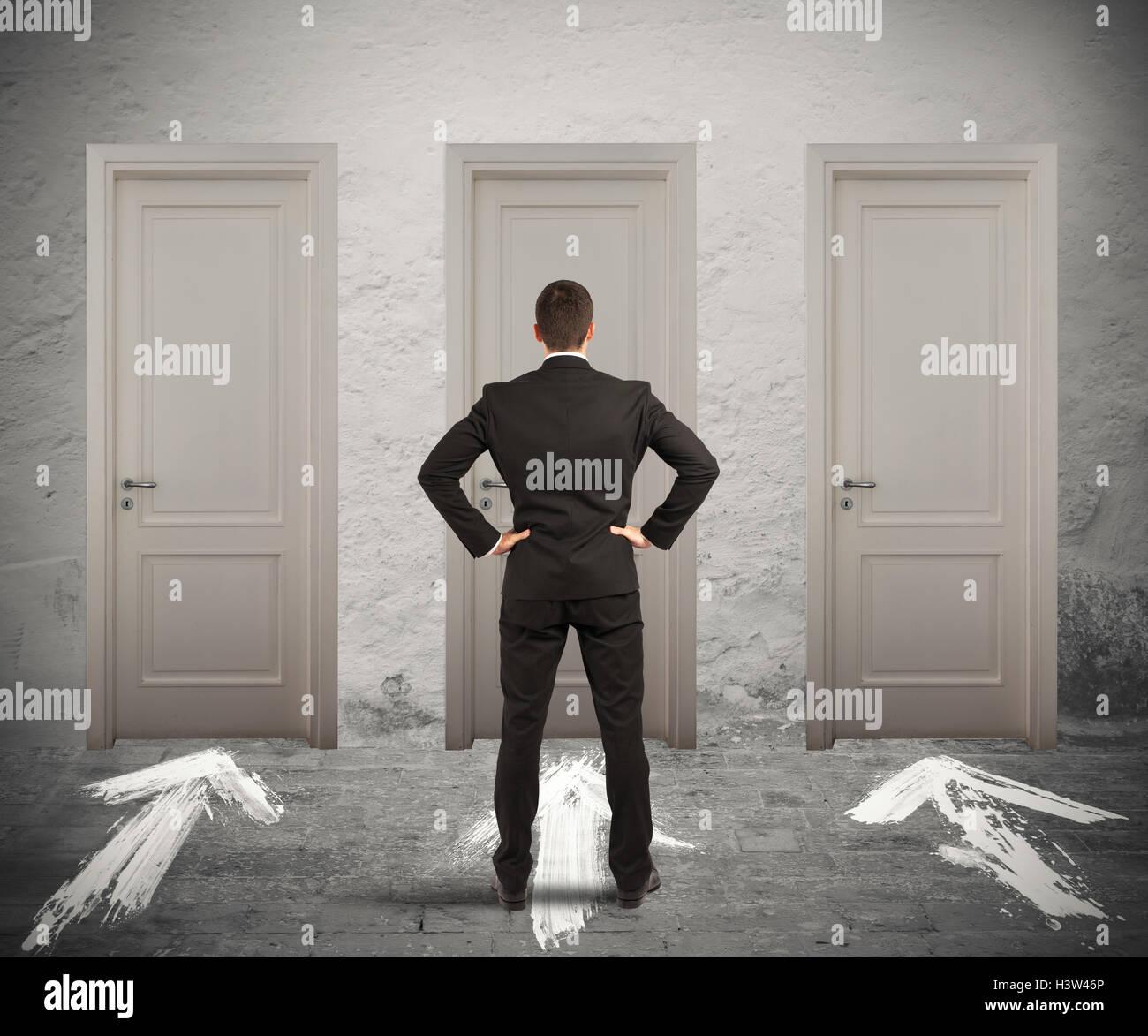 Businessman choosing the right door - Stock Image