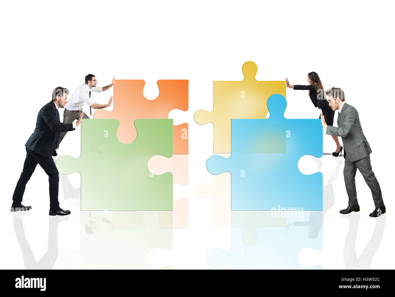 Concept of teamwork and partnership with businesspeople and puzzle. - Stock Image