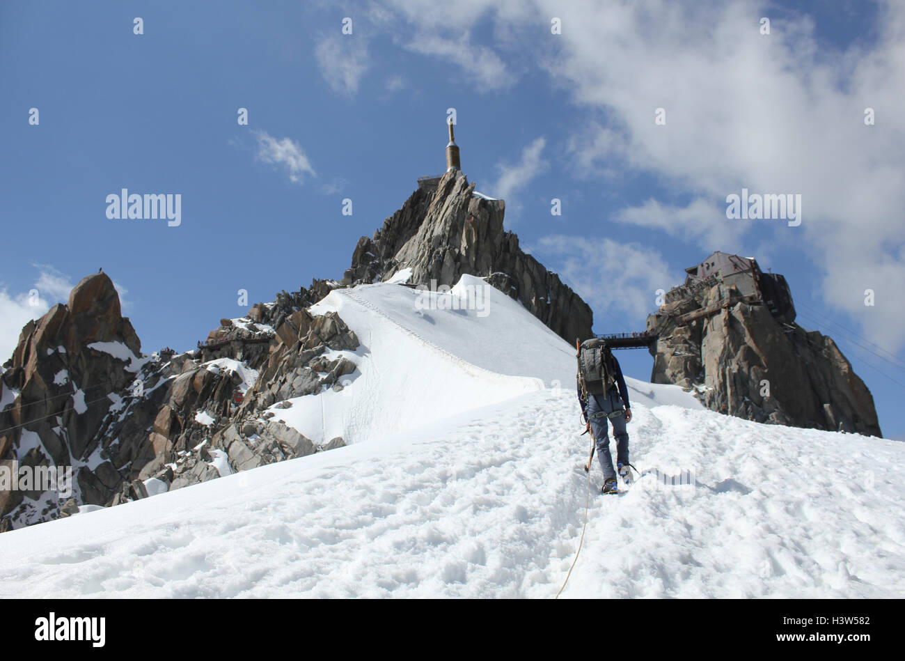 Approaching the Aiguille du Midi cable car after a day climbing on the Mountain - Stock Image