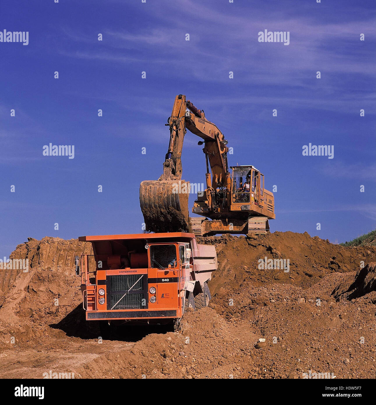 Road construction, excavator, truck, charge, construction, building trades, building industry, construction, construction - Stock Image