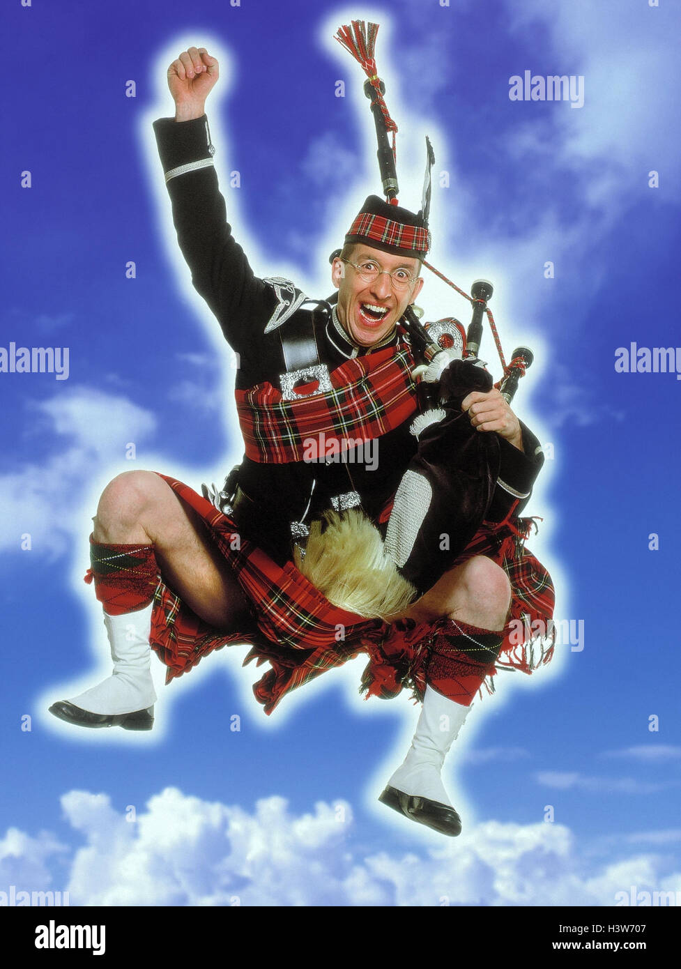 Bulkheads, kilt, bagpipes, caper, gesture, enthusiasm, cloudy sky studio, man, national costume, clothes, traditionally, - Stock Image