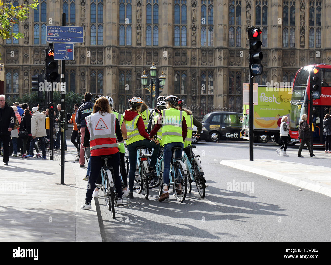 Cyclists using cycle lane traffic light segregated - Stock Image