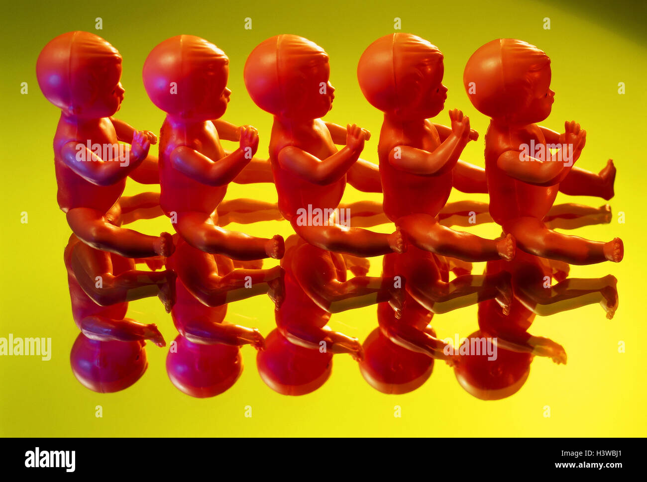 Toys, baby dolls, sit, 'clone' one after the other, identically, icon, preview, mirroring dolls, descendants, - Stock Image