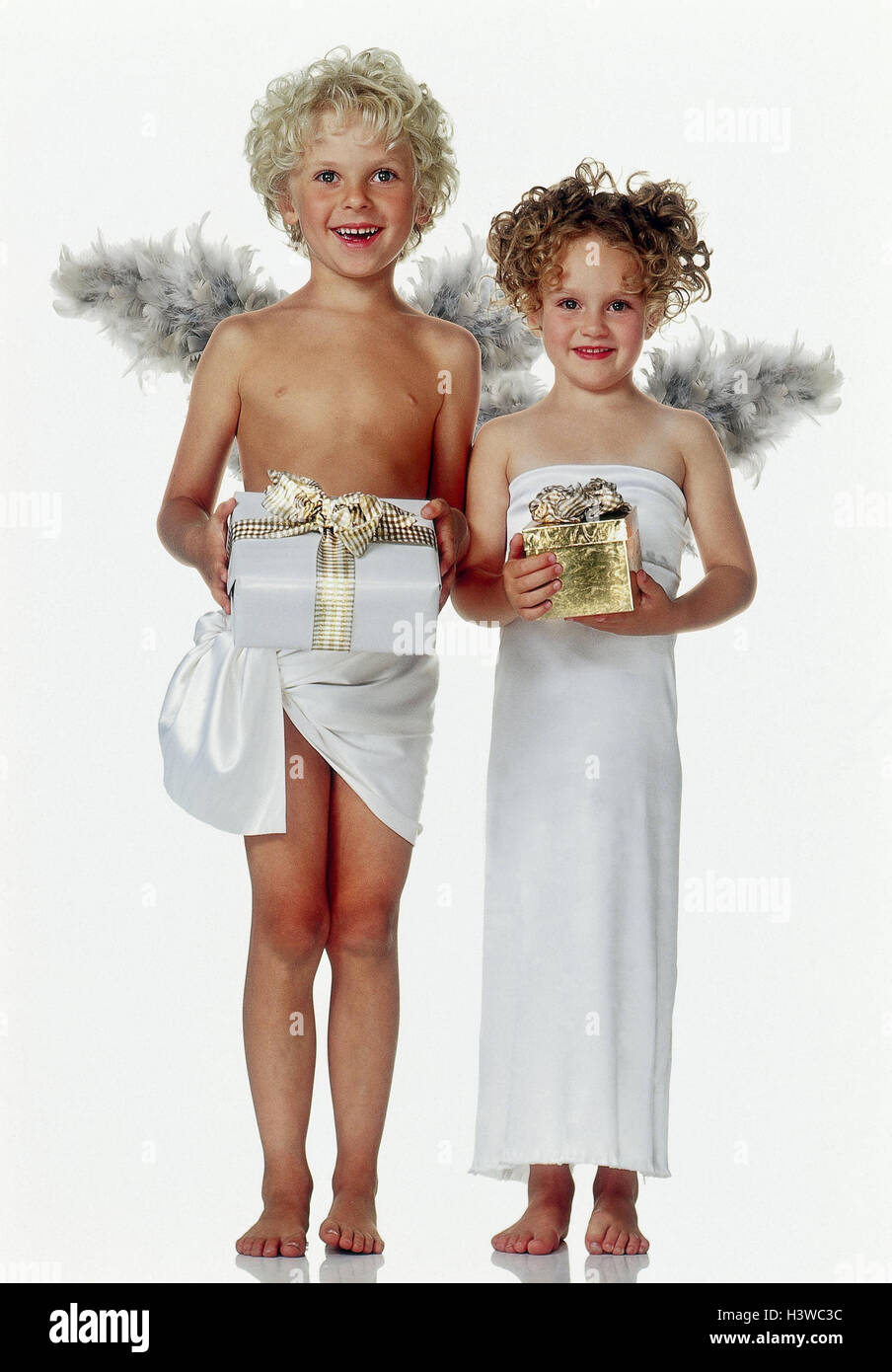 Boy, girls, angels, Christmas presents x-mas, Christmas, children, two, curls, lining, wing, stand, packages, presents, - Stock Image
