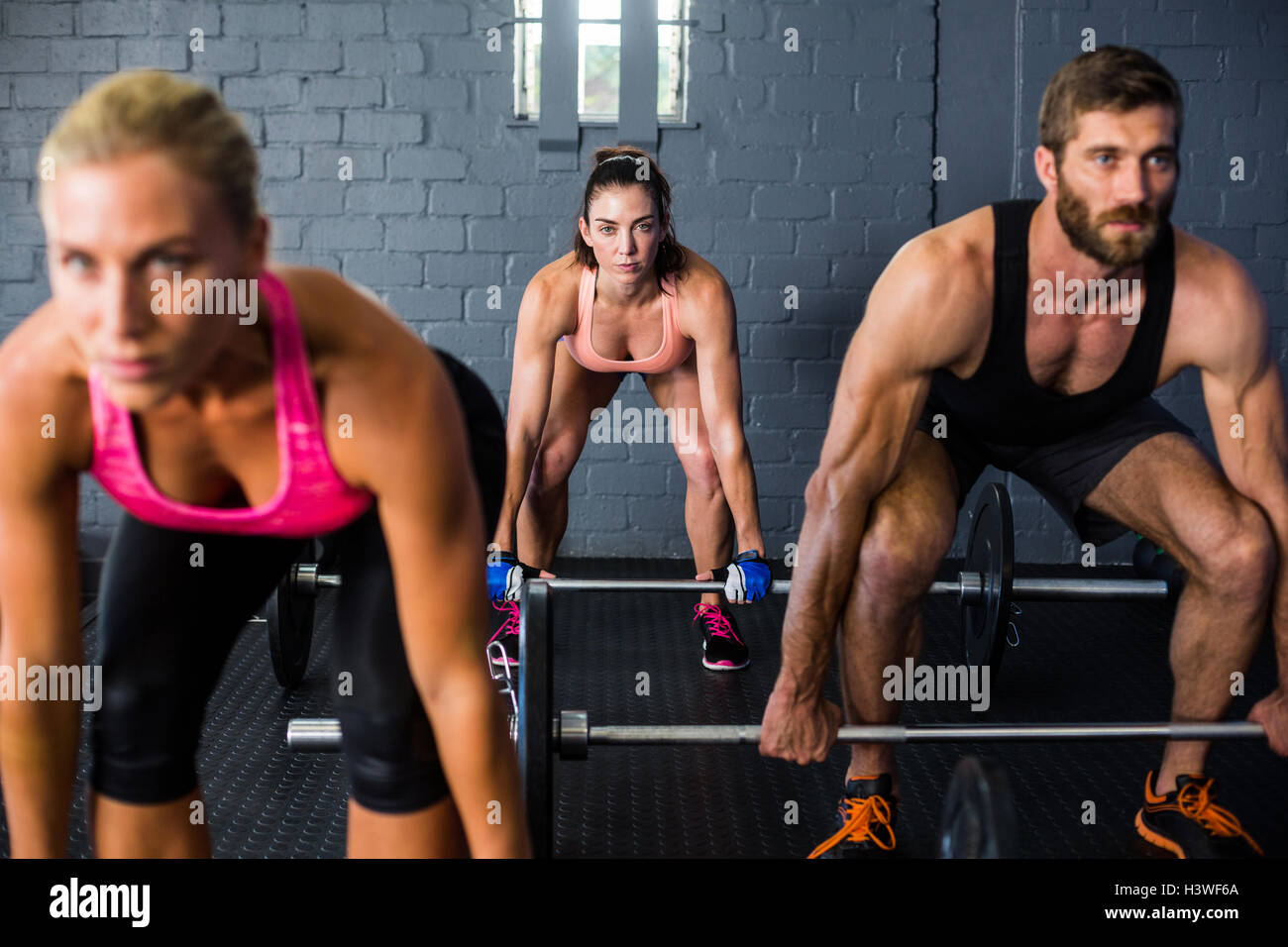 Athletes lifting barbell - Stock Image