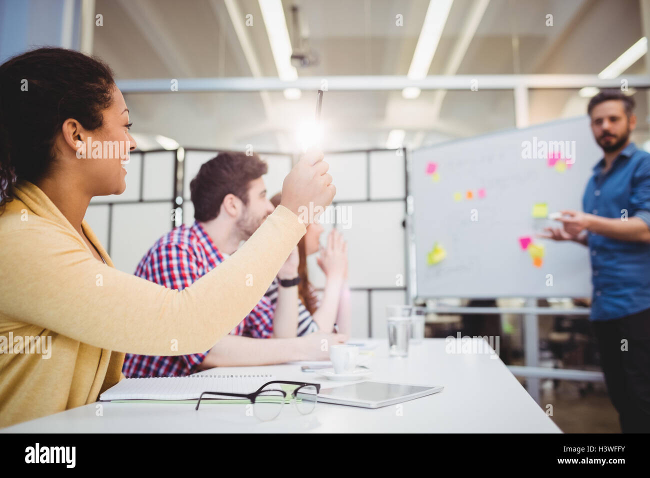 Colleagues in board room during brainstorming session at creative office - Stock Image