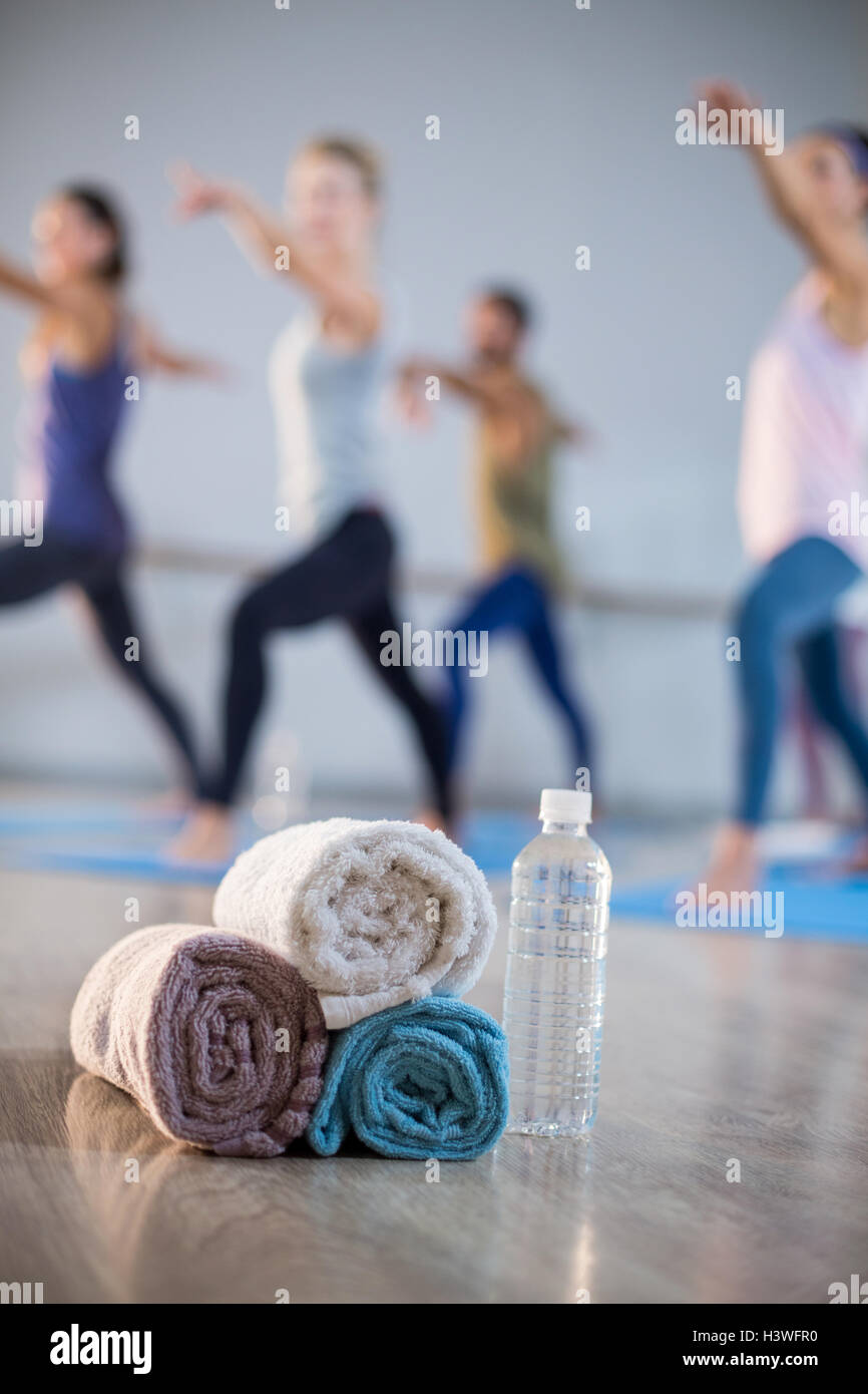 Close-up of towel and water bottle - Stock Image