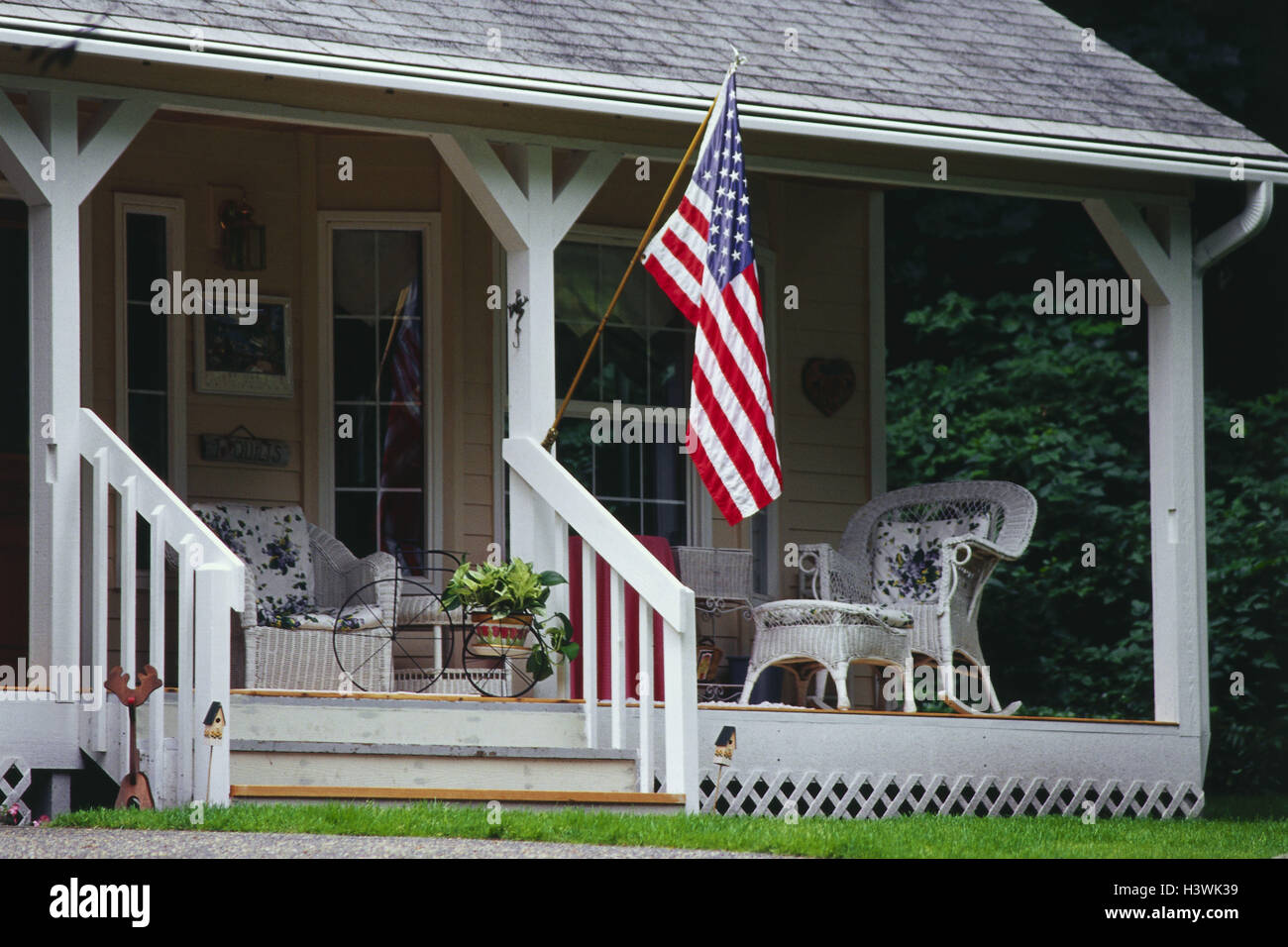 The USAu0027 Oregon, Portland, Farmeru0027s House, Veranda, Outdoor Furniture,  Wicker Piece Furniture, Flag, In American Manner, Plant, Trees, Shrubs,  Outside