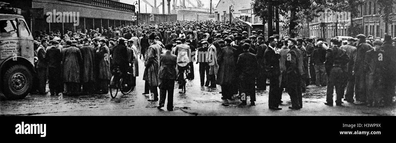 Photograph of the strikes outside the Surrey Docks, part of an industrial dispute involving dock workers. Dated - Stock Image