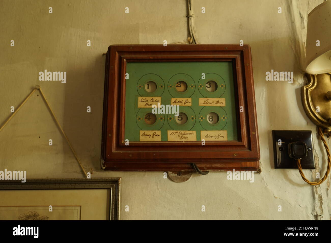 Victorian bell panel for servants to answer calls - Stock Image