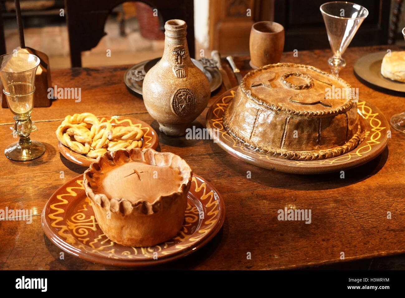 Elizabethan dining table set with typical foods - Stock Image