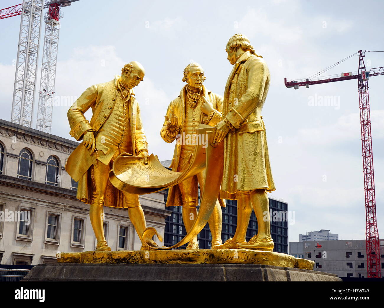 Gold statue titled 'Boulton, Murdoch and Watt' by William Bloye - Stock Image
