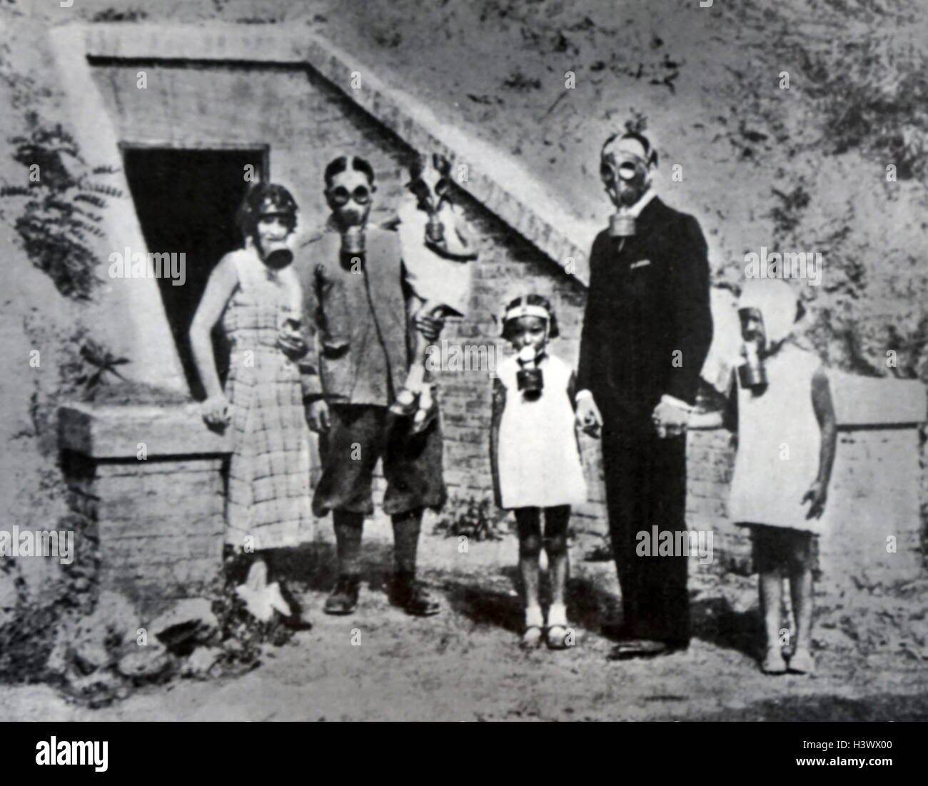 Photograph of Italian family wearing gas masks  Dated 20th Century