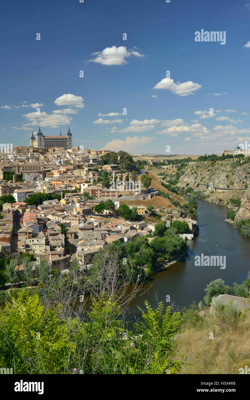 Toldeo, Toledo, SPAIN. 13th June, 2013. Toledo, Spain, and the Tagus River. The Alcazar Fortress sits atop the hill. - Stock Image