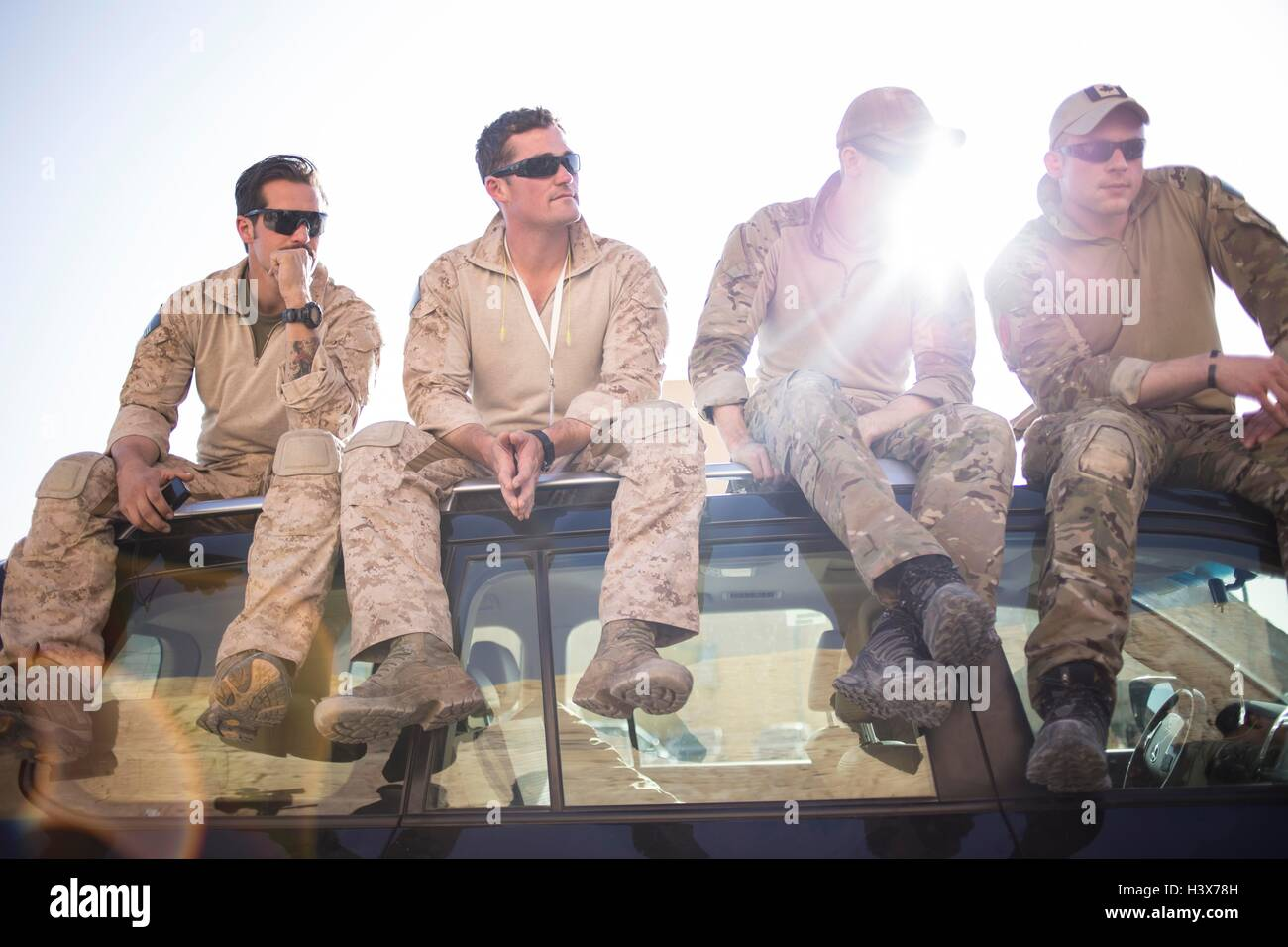 Amman, Amman, Jordan. 19th Apr, 2015. Members of the American and Canadian teams watch the remaining teams compete Stock Photo