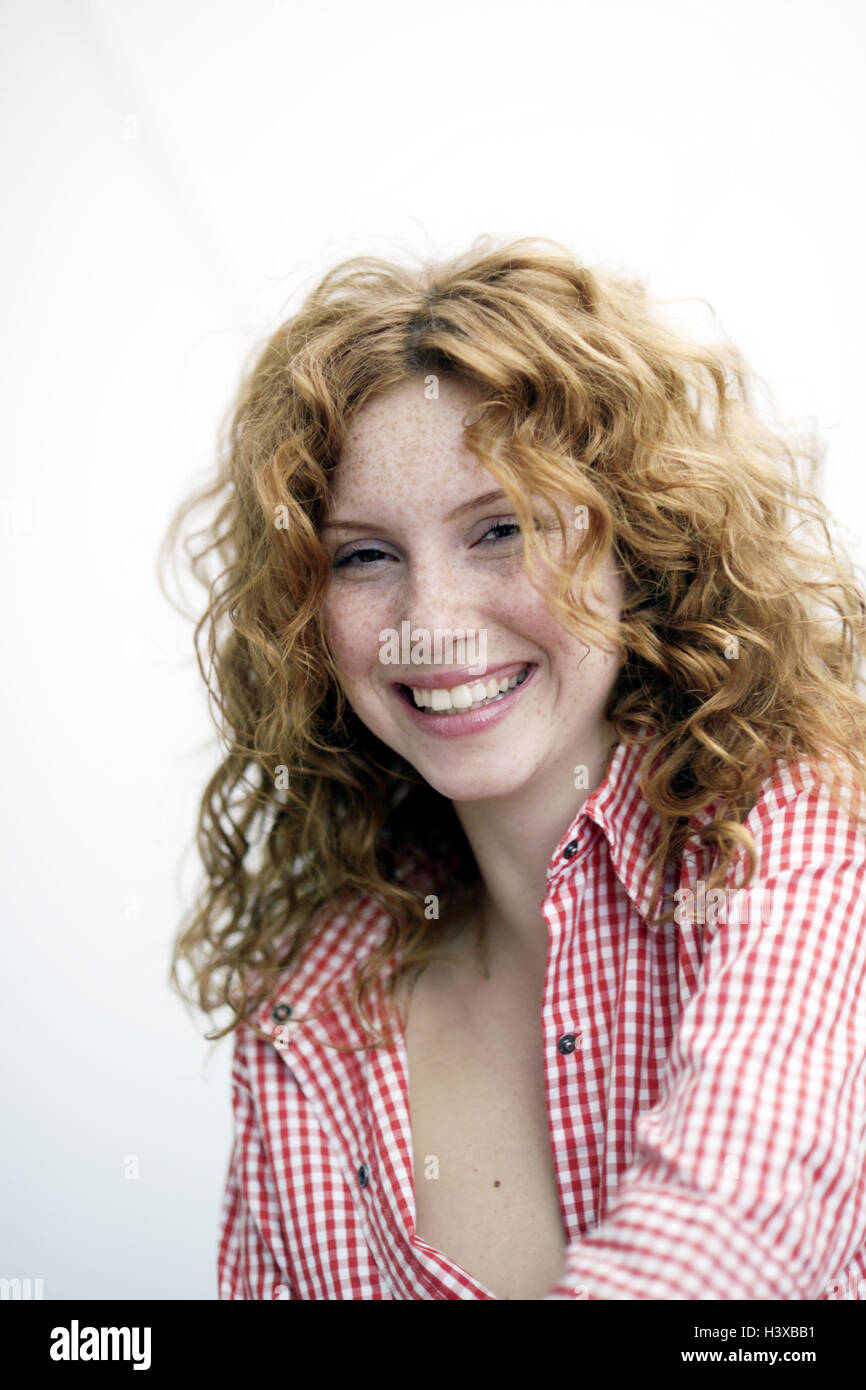 Woman, smile, red-haired, curls, portrait, redheads, young, course, naturalness, happy, calmly, calmness, self-confidence, - Stock Image