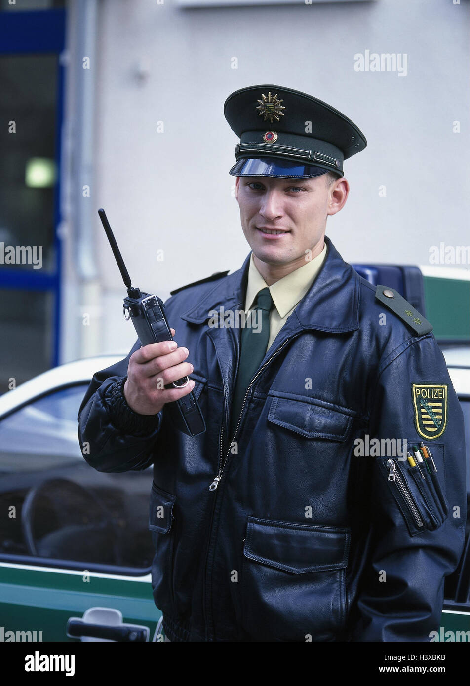 Policeman, transceiver, half portrait, occupation, work, work, police, man, uniform, police uniform, police officer, - Stock Image
