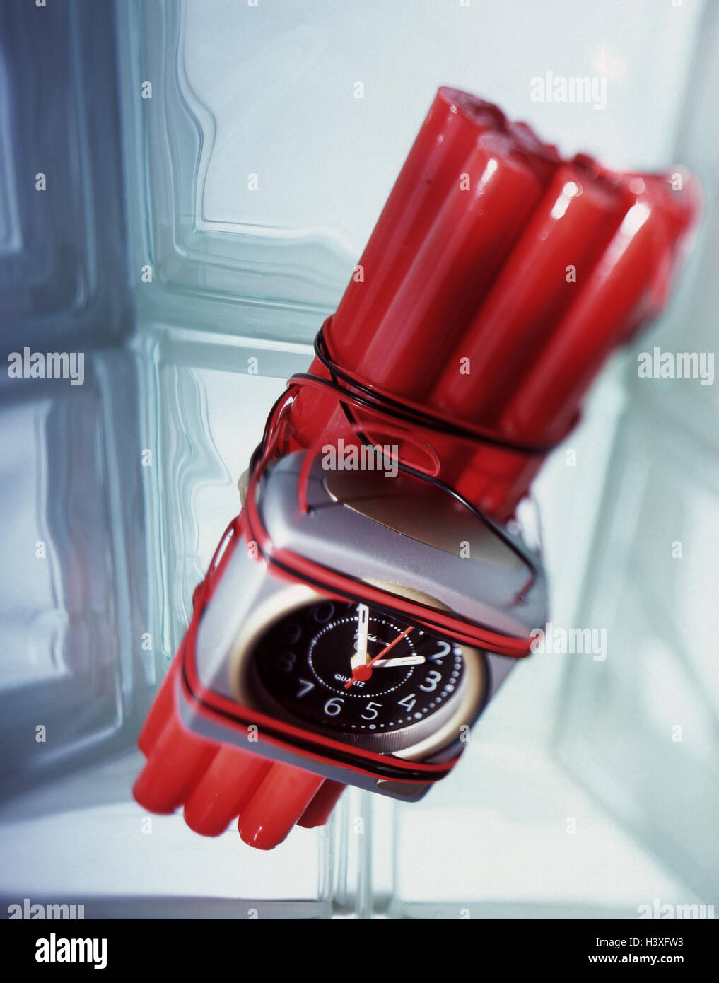 Dynamite sticks, time fuses, explosive charge, sprinkle, terrorism, weapon, clock, alarm clock, spraying, crime, - Stock Image