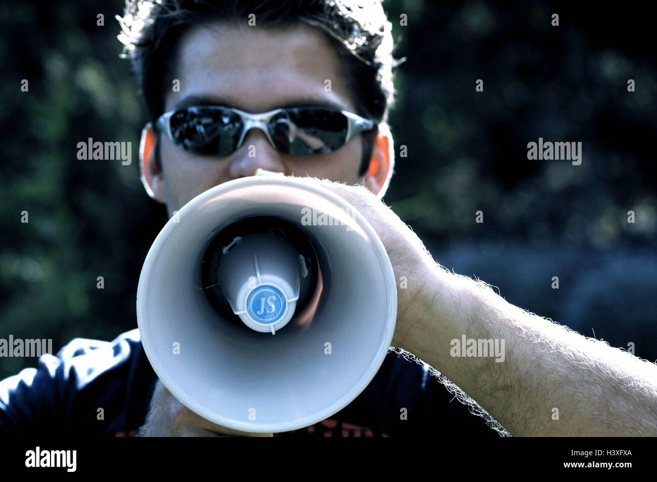Man, sun glass, megaphone,  Announcement, announcement, information,  loudly, portrait  24 years, 20-30 years, communication, - Stock Image