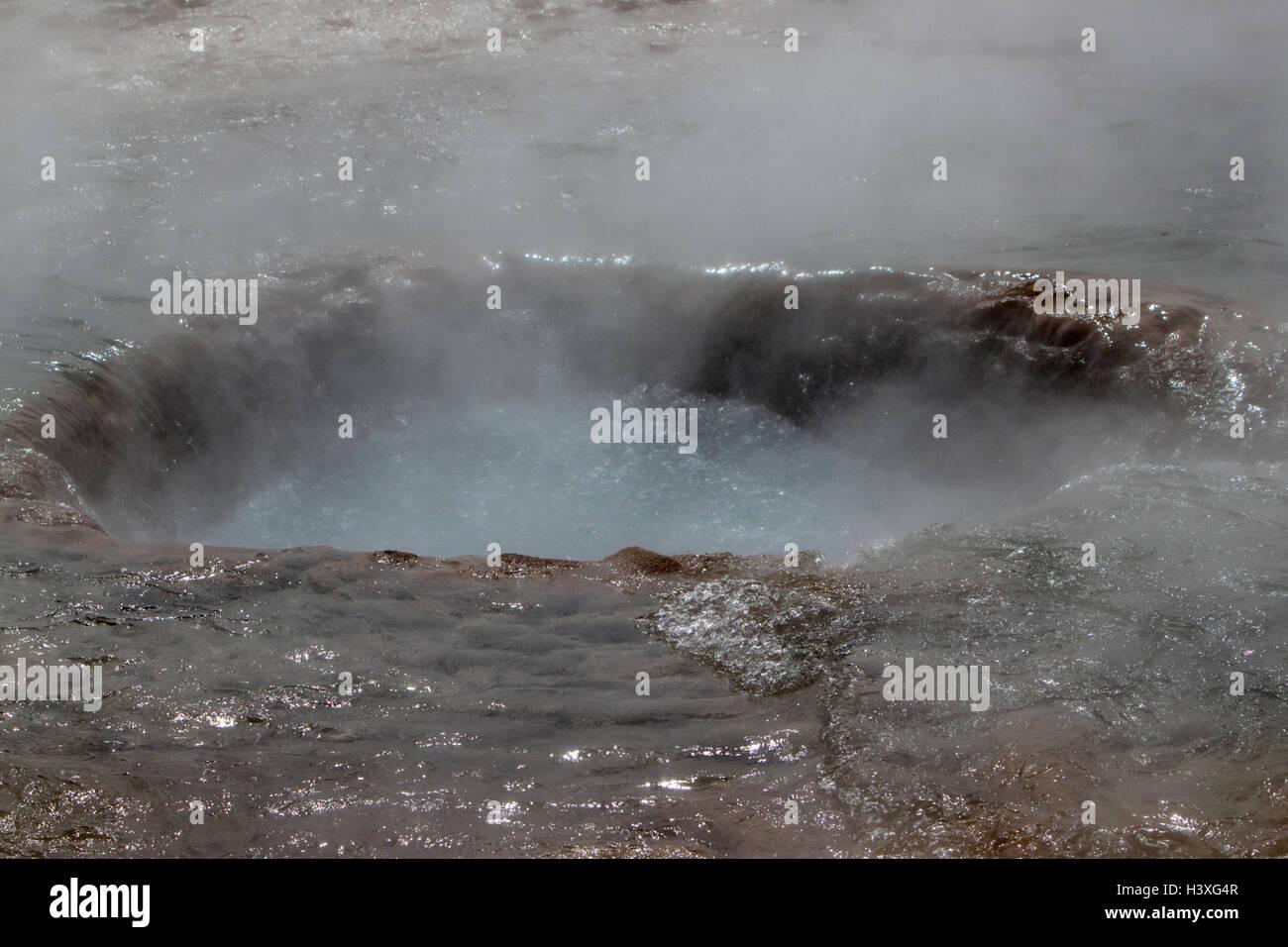 water draining into strokkur geyser after eruption phases geysir Iceland - Stock Image