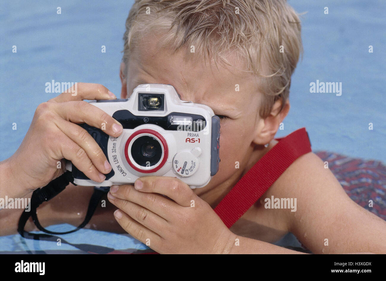 Pool cymbal margin boy camera portrait model released swimming